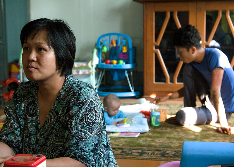 Shining meets with potential donors while Danu, her husband, looks after their son, Sai Federal, in the background.