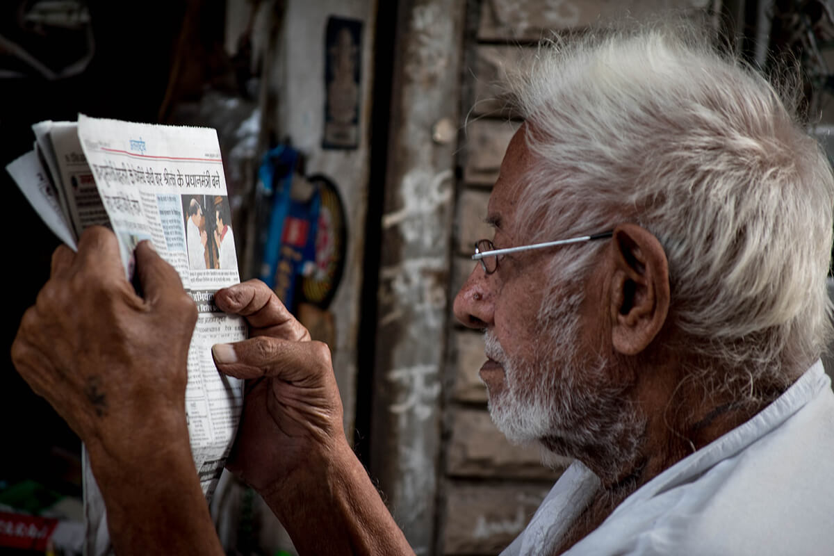 Older man reading news